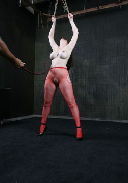Beautiful Slave in Fishnet Stockings Gets Whipped Hard in the Dungeon