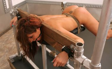 Beautiful Slave in Stocks Gets Anally Penetrated and Dominated Hard