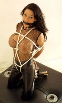 Glamorous Busty Brunette in Latex Bound, Collared and Cleave Gagged