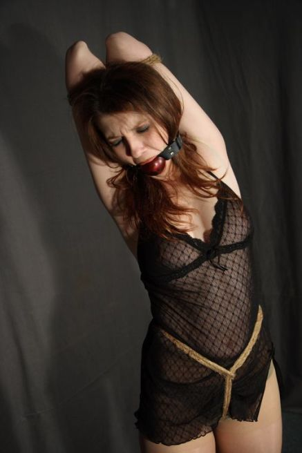 Gorgeous Brunette in Black Slip Gets Tightly Bound and Ball Gagged