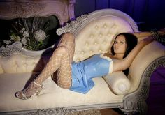 Gorgeous Young Brunette in Fishnet Stockings Chained in the Boudoir