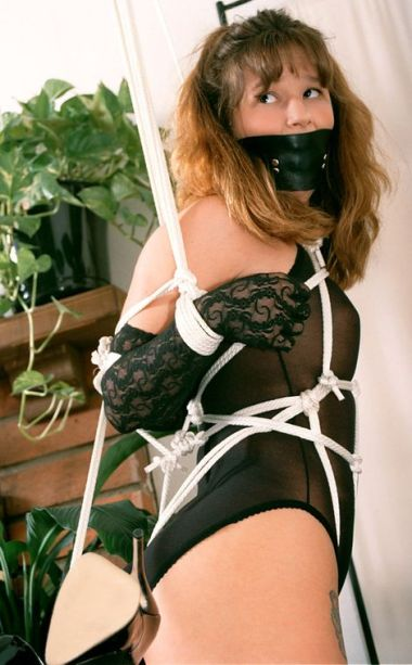 Gorgeous Young Brunette in Stockings Gagged and Bound for Discipline