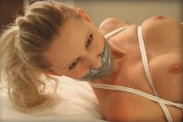 Kinky Young Blonde Gets Tape Gagged, Bound and Hogtied for Punishment