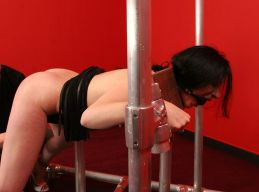 Pretty Brunette Slave in Stocks Whipped and Tortured in the Dungeon