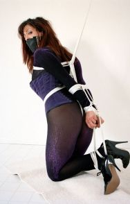 Sexy Mature Brunette in Corset Tightly Bound and Gagged for Punishment