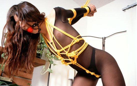 Sexy Young Brunette in a Bodystocking Ball Gagged and Tightly Bound