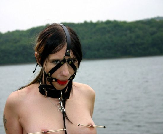 Young Brunette Slave in High Heels Gets Harnessed and Collared Outside