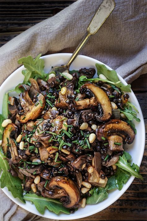 a bowl of fried mushrooms and pine nuts