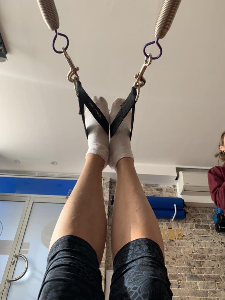 legs in pilates spring