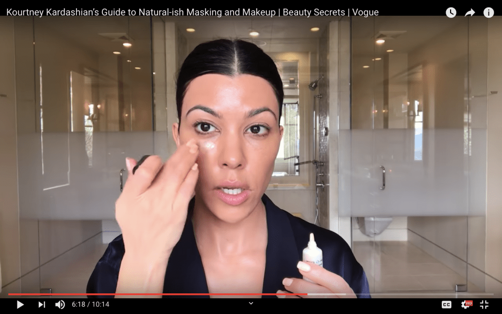 Kourtney Kardashian applying her makeup with her hands for Vogue Beauty Secrets