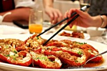 Steamed Baby Lobster with crispy fried Garlic and Scallions.