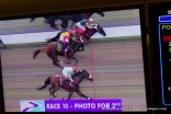 No one could and it was replayed on Photo Finish to be determined.