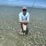 fisherman with bonefish on andros flats