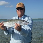 fly fisherman holding bonefish