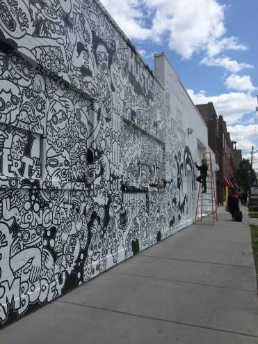 Lauren Asta completing a Chicago mural