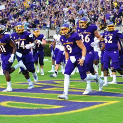 Celebration ensues after quarterback Philip Nelson (9) scores the first points of the season for East Carolina. (W.A. Myatt photo)
