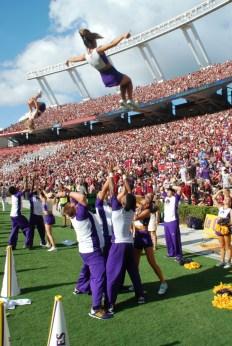 ECU cheerleaders get up for the Pirates at Williams-Brice Stadium.