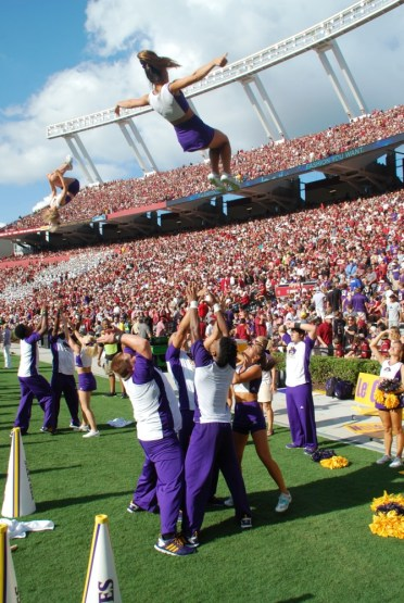 ECU cheerleaders get up for the Pirates at Williams-Brice Stadium.