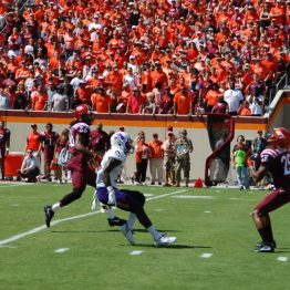 ECU's Chris Love arrives as Virginia Tech punt returner Greg Stroman makes a fair catch on the punt following Stroman's 87-yard return for a touchdown. (Photo by Al Myatt)