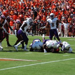 ECU defenders combine to stop Virginia Tech's Travon McMillan on a third down. (Photo by Al Myatt)