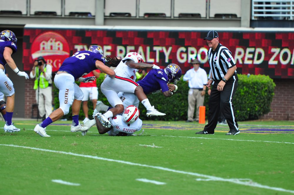 Junior running back Anthony Scott refuses to be denied on a five yard touchdown run that would ultimately seal a victory for the Pirates. (WA Myatt photo)