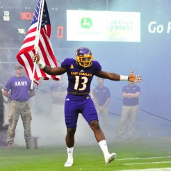 Linebacker Pat Green carries the American flag as he emerges from the tunnel to face Western Carolina Saturday evening. (W.A. Myatt photo)