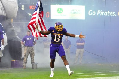 Linebacker Pat Green carries the American flag as he emerges from the tunnel to face Western Carolina Saturday evening. (Bonesville Staff photo)