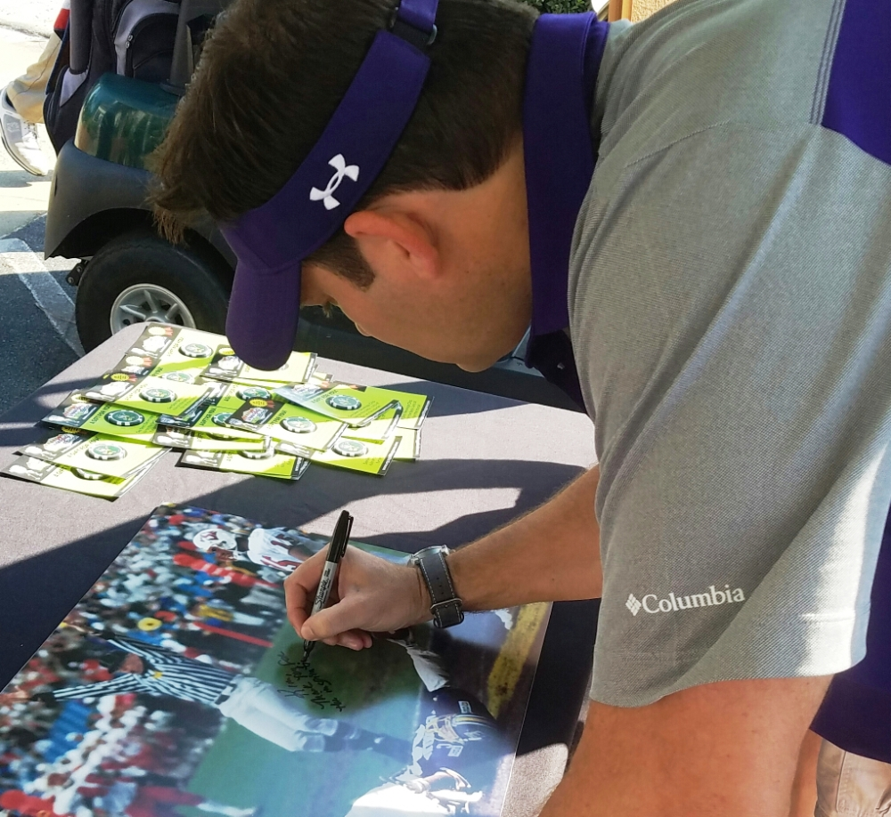 Luke Fisher pens a very special autograph for Kim Reaves, wife of ECU coach's show photographer and producer Brian Meador. (Submitted photo)