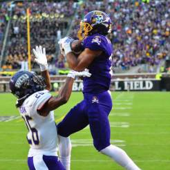 Wide receiver Quay Johnson rises above WCU defensive back Trey Morgan to haul in a touchdown pass from Philip Nelson. (W.A. Myatt photo)