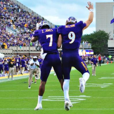Zay Jones (7) and Philip Nelson (9) celebrate after a touchdown. The two would later connect. The duo had a strong showing in the season opener - Nelson threw for 398 yards and 5 touchdowns, completing 28-32 attempts and Jones had ten catches for 180 yards and a touchdown reception. (Bonesville Staff photo)