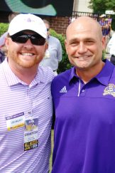 ECU baseball coach Cliff Godwin (right) is joined by Pirate supporter Lee Mulkey on the sideline.