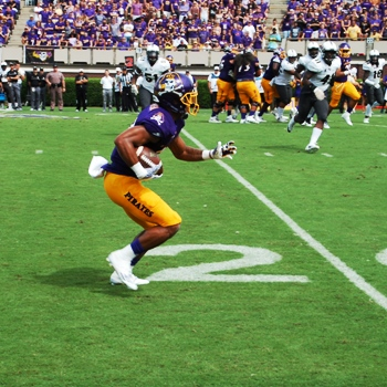 ECU's Quay Johnson looks for running room after a reception on the Pirates' first scoring drive. (Photo by Al Myatt)