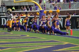 Cheerleaders get their push-ups in after an ECU score.