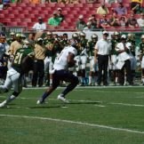 James Summers carries the ball after a handoff as the Pirates looked to establish the ground game early.