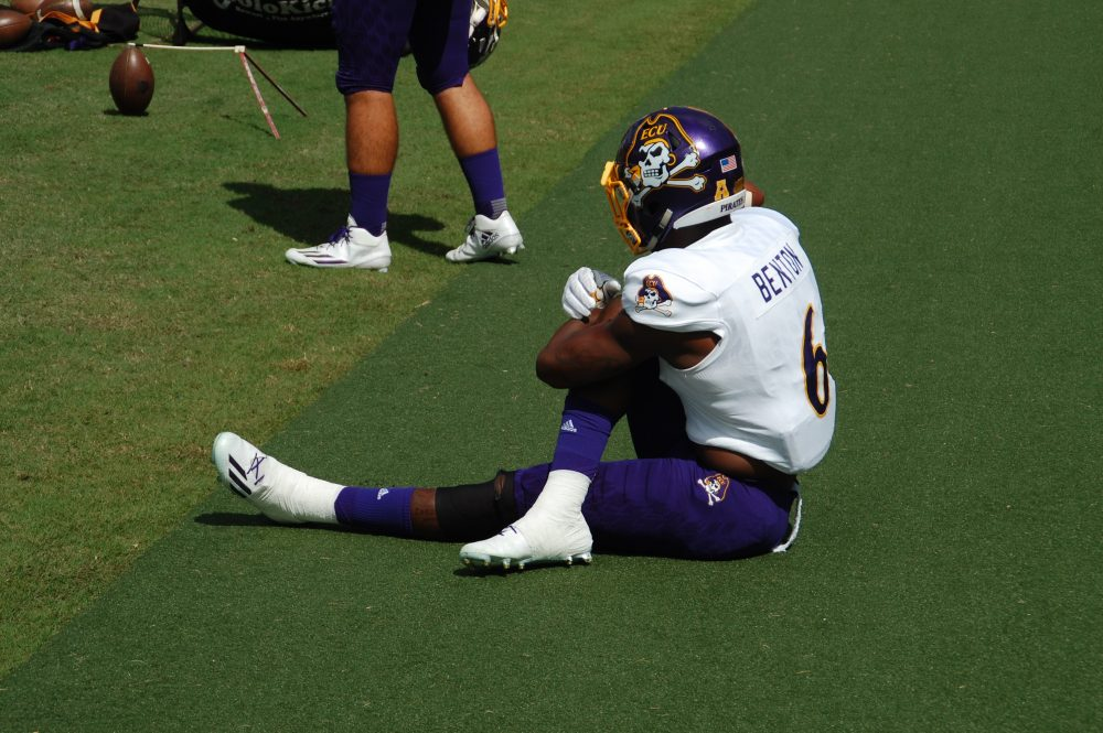ECU defensive back Darius Benton stretches on the sideline of a contest at South Florida on Saturday.