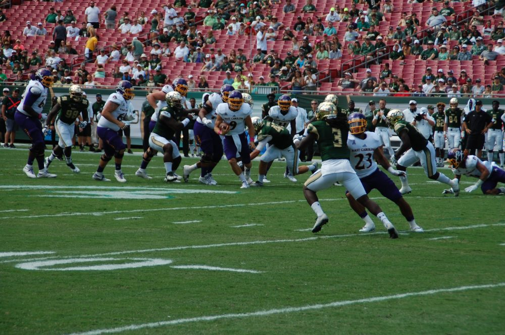East Carolina quarterback Philip Nelson scrambles as Quay Johnson looks to provide a block downfield.