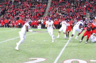 ECU quarterback Philip Nelson tosses to running back James Summers.