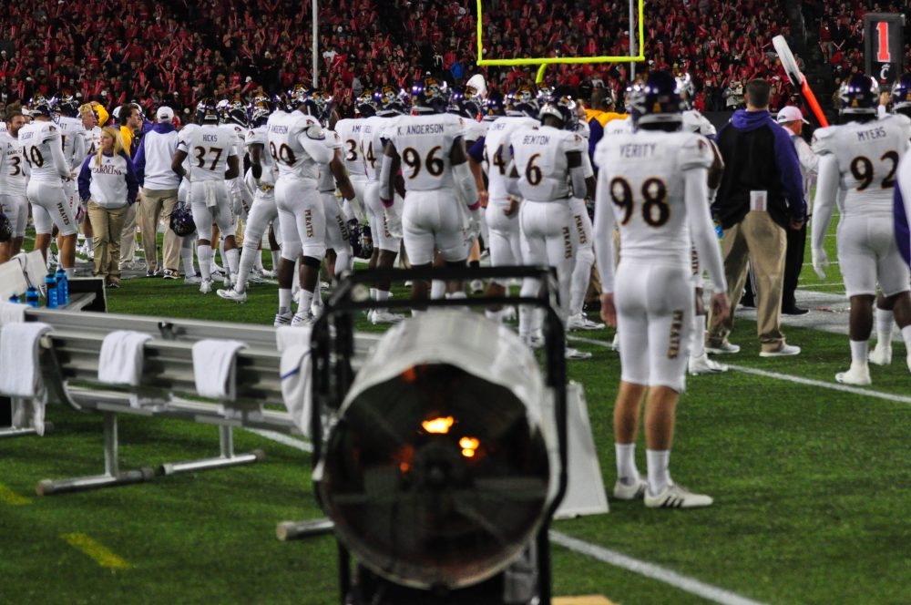 A big heater warms the ECU sideline at Nippert Stadium.