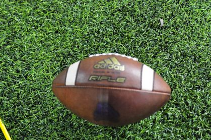 An adidas East Carolina football on the synthetic turf at Cincinnati.