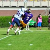 Standout wide receiver Zay Jones hauls in a pass from Philip Nelson despite strong coverage from UCONN defensive back, Jamar Summers. (W.A. Myatt photo)