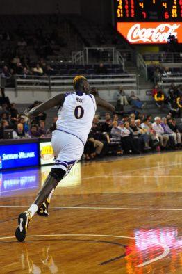 Deng Riak gets his long frame into defensive transition. (Al Myatt photo)