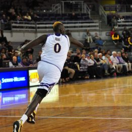 Deng Riak gets his long frame into defensive transition. (Al Myatt photo)