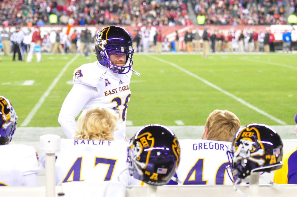 Pirate kicker Davis Plowman talks with punter/holder Worth Gregory. (Al Myatt photo)