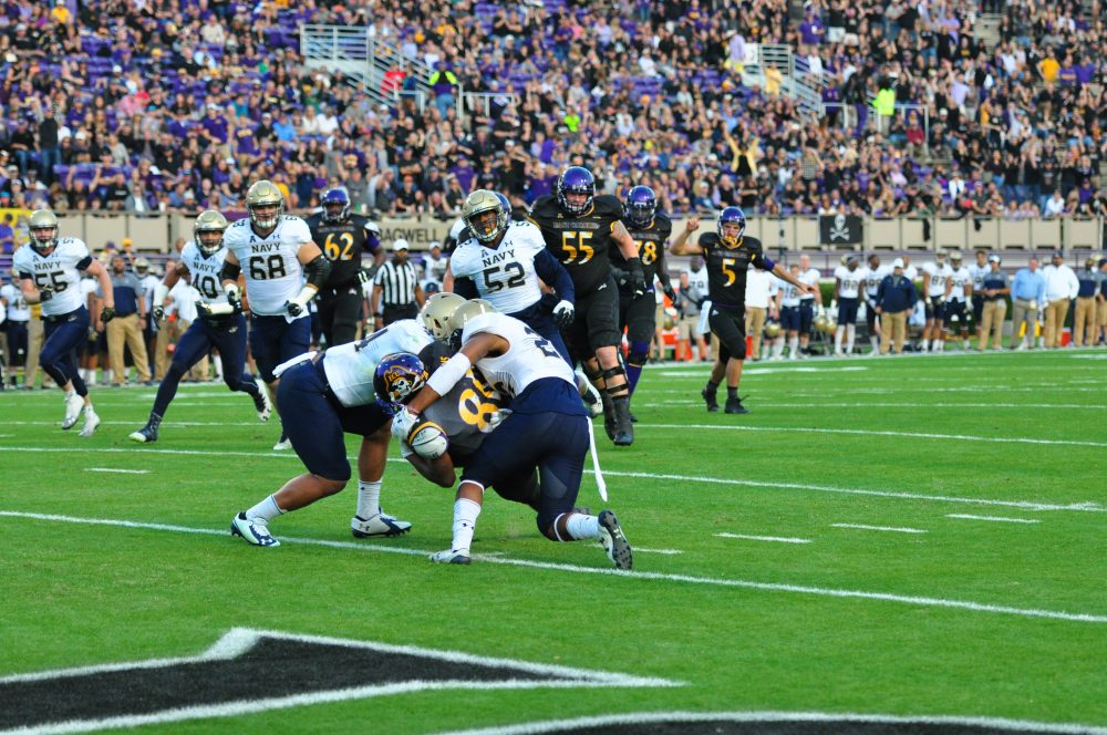 Senior wide receiver Jimmy Williams splits two Navy defensive backs on a six yard touchdown reception to put East Carolina ahead 14-7 early in the first quarter. (Bonesville Staff)