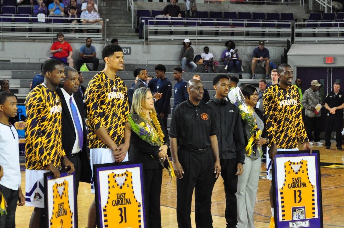 ECU's seniors, with family members, are from left, Caleb White, Andre Washington and Michel Nzege (Al Myatt photo)