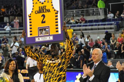 East Carolina coach Jeff Lebo made an appearance as Pirate seniors were recognized before the game. Lebo is at the right as Caleb White displays his framed jersey (Al Myatt photo)