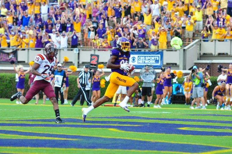 Senior wide receiver Davon Grayson hauls in a 9-yard touchdown pass from Gardner Minshew on the Pirates opening drive against VPI Saturday afternoon. (Photo by W.A. Myatt)