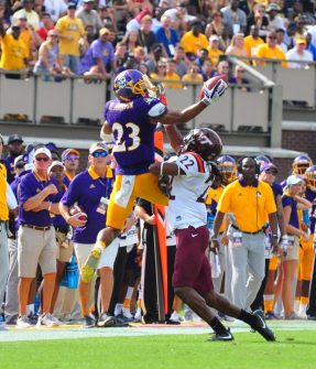 Senior wide receiver Quay Johnson goes up over VPI safety Terrell Edmunds to make a spectacular one-handed grab in the first half of Saturday afternoon's contest. (Photo by W.A. Myatt)