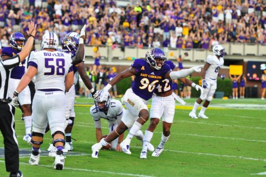 Defensive end Kiante Anderson points to the ECU sideline after a tackle for loss in the first half of Saturday's contest with James Madison.