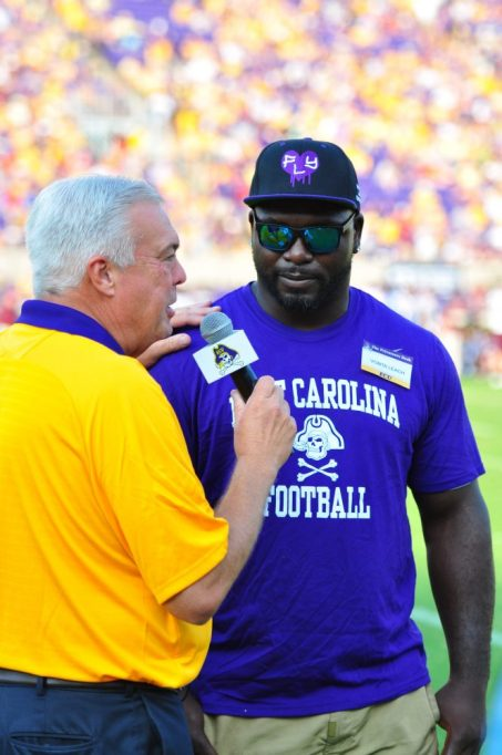 Bonesville columnist and WNCT-TV sports director Brian Bailey interviews Pirate great and Super Bowl Champion Vonta Leach. (Photo by Bonesville Staff)